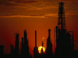 Oil Refinery Silhouetted During a Dramatic Sunset