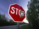 Stop Sign with a Large Bullet Hole