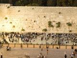 Jewish Men and Women Pray at the Western Wall at Night