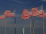 Back of the Statue of Liberty Is Seen Between American Flags