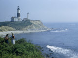 People Stand on Point across Bay from Montauk Point Light