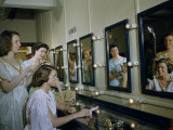 Members of an Opera Chorus Put on Costumes in a Dressing Room