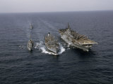 Navy Ships Refuel at Sea  Last Ship Acts as Guard for Men Overboard