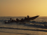 Fishermen Launch their Boat into the Atlantic Ocean at Sunset