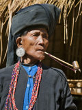 Old Woman of Small Ann Tribe in Traditional Attire Smoking a Pipe  Sittwe  Burma  Myanmar