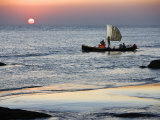 Crew of Fishing Boat Hurries Home to Sittwe as Sun Sets over the Bay of Bengal  Burma  Myanmar