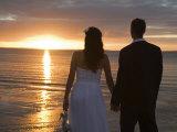 Couple Hand in Hand Watch Sun Set from Beach  Kingfisher Bay  Fraser Island  Queensland  Australia
