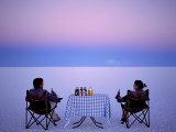 Tourists Enjoy Sundowners While Looking Out across the Endless Salt Crust of Salar De Uyuni