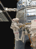 Astronauts Working on the Hubble Space Telescope During a Spacewalk