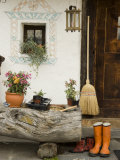 Boots  a Broom and Flowers Outside a Chalet