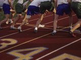 Runners Lined Up on a Track Ready for the Starting Gun