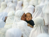 Acehnese Woman Holds a Child after Eid Al-Adha Prayer in the Tsunami-Ravaged Town of Meulaboh