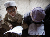 Afghan Refugee Children Read Verses of the Quran During a Daily Class at a Mosque in Pakistan