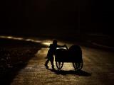 Pakistani Boy Pushes a Cart Along the Main Street in Rawalpindi  Pakistan
