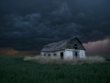 Old Barn Stands in a Wheat Field as a Thunderstorm Passes in the Distance Near Ogallah, Kansas Papier Photo