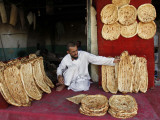 Baker Arranges Breads at His Shop in Kandahar Province  South of Kabul  Afghanistan