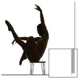 Woman Balancing on Chair and Doing Yoga