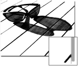 Black and White Image of Sunglasses and their Shadow on a Table