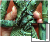 Fingers Holding the Waist of a Bronze Shiva Statue