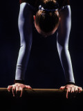 Female Gymnast Balancing on Beam with Hands  Close-Up