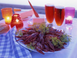 A Plate Full of Crayfish  Glasses with Beer and Lit Candles