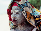 A Woman Wears Ground Bark Cream to Protect Her Face from the Sun
