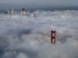 A Glowing Tower of the Golden Gate Bridge Rises Above the Fog