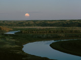 The Moon Rises over Low Hills Banking the Missouri River