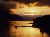 Cloud-Filtered Sunset Silhouettes a Boat on the Sheltered Waters of Bonne Bay
