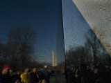 Visitors and Washington Monument Reflected in the Vietnam Memorial