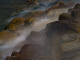 Steaming Water Flows over Rocks Stained by Algae and Bacteria