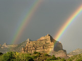 A Pair of Rainbows after a Storm over a Rocky Outcrop