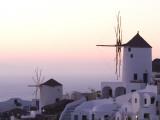 Stuccoed Houses and Windmills on a Hillside at Twilight