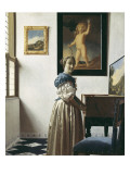 A Young Woman Standing at a Virginal
