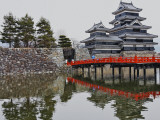 Matsumoto Castle with Moat  Stone Work and Red Wooden Bridge
