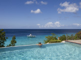 Swimmer in Infinity Pool at Habitat Curacao Dive Resort Near St Willibrordus