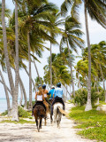 Tourists Horseback Riding Along Beach Trails