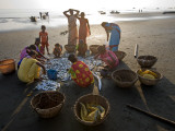 Villagers Looking at Fishing Catch on Beach