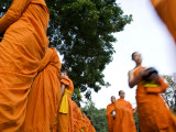 Buddhist Monks on their Morning Walk to Collect Food