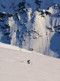 Woman Skiing on Daltinden in Midnight Sun