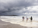 Young Surfers Entering Sea at Meron Beach
