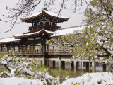Snow Covered Chinese Style Bridge over Pond in Garden of Heian Shrine