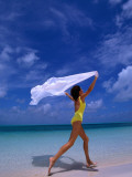 Woman Running on Beach with White Sarong Overhead