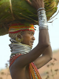 Portrait of a Bondo Woman Carrying a Load on Her Head Walking to Market  Early Morning
