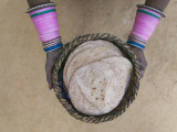 Overhead of Woman Holding a Bakset of Chapatis