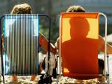 Man and Woman on Beach Chairs  Copacabana Beach