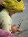 Pilgrim from Nepal Praying to River Ganga