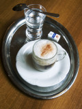 Coffee  Traditionally Served on Oval Metal Tray with a Glass of Water