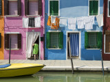 Boats and Colourful Houses Along Canal
