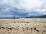 Man Walking on Beach after Storm